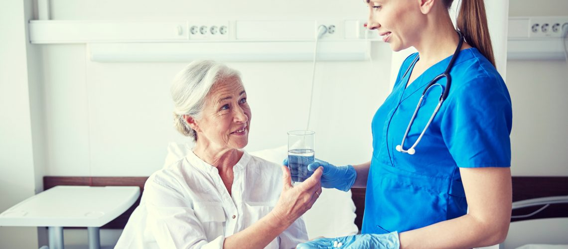 Preview nurse-giving-medicine-to-senior-woman-at-hospital-PVXELCK